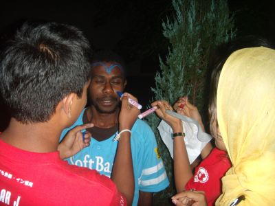 Lionel from Vanuatu getting his face painted
